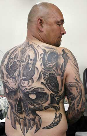 Mark of art: Jason Wright wears back art by tattooist Holger Mauersberger.