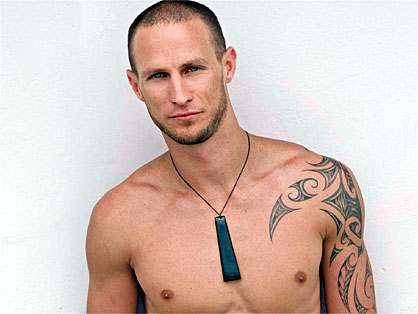 officially one of New Zealand's hunkiest men. But the taut and tattooed