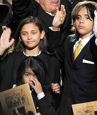 Michael Jackson's daughter Paris Jackson and two sons Prince Michael Jackson II and Prince Michael Jackson I wave at the end of a memorial service for their father at the Staples Center in Los Angeles.