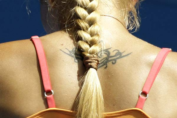 Ukraine's Alona Bondarenko's tattoo is discreet behind her ponytail.