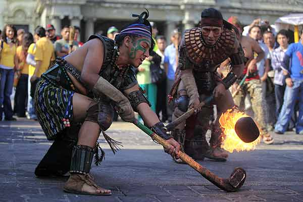 Performers take part in an exhibition game of Maya Ball during an intercultural event in Guatemala City.