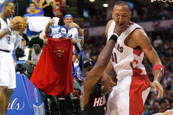 An Orlando Magic fan offers a Superman cape to Magic centre Dwight Howard, who is nicknamed