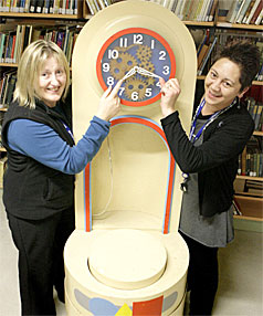 OUT OF THE VAULTS: Invercargill librarians Jill Harper, left, and Lyndsay Tautari with the Play School clock in the library's archive yesterday.