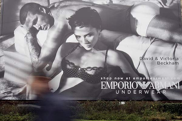 A maxi advertising campaign for Armani underwear with David Beckham and his wife Victoria is pictured in downtown Milan.
