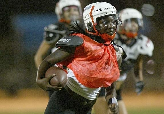 Miami Caliente Quarterback Andaka Dixon Runs Play During