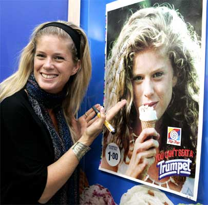 POSTER GIRL: Rachel Hunter in 2007 signing a poster from the Tip Top ad that launched her career.