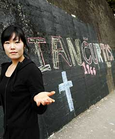 GONE BUT NOT FORGOTTEN: Graffiti going back 28 years fell to  a council blackout but Joanne Sung, of  Mt Cook Cafe, found  it  back, in chalk.