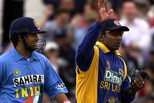India's Sachin Tendulkar and Sri Lanka's Mahela Jayawardene walk from the field with an injured pigeon that was struck by the ball during the Natwest triangular Series match at the Oval in London.