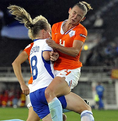 The Netherland's Manoe Meulen (right) and Finland's Linda Sallstrom run into each other during their UEFA women's Euro 2009 soccer match in Helsinki.