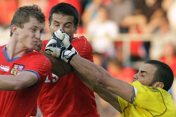 Czech Republic's Tomas Necid (left) and Milan Baros (centre) collide with San Marino's goalkeeper Aldo Simoncini during their World Cup 2010 qualifying football match in Uherske Hradiste.