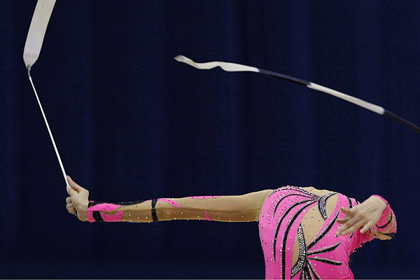Vojislava Cekerevac of Serbia seems to have lost her head as he performs with the ribbon during the qualifying round of the Rhythmic Gymnastics World Championships in Ise, Mie prefecture, central Japan.