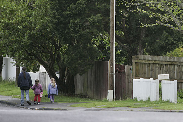 NEIGHBOURHOOD: Children walk down the road after a two year old girl who went missing from her home in Longburn Road in Henderson.