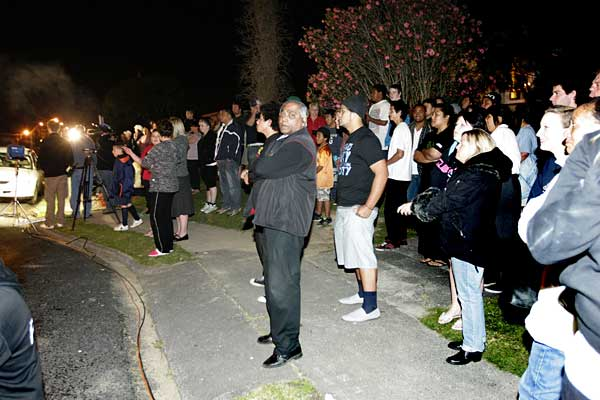 WATCHING AND WAITING: The crowd gathered outside the west Auckland property where searchers were search dig, near the location where Aisling Symes went missing a week ago.