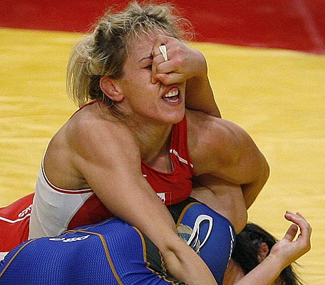 Canada's Lindsay Rushton (top) tries to pin Japan's Makiko Sakamoto during their women's 48 kg free style match at the World Wrestling Championships 2009 in Herning.