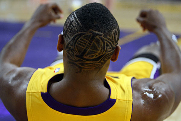 Los Angeles Lakers Ron Artest displays a Lakers logo haircut during their NBA basketball game ag