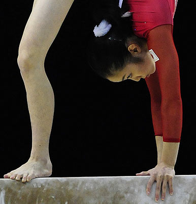 Koko Tsurumi of Japan competes on the beam in the qualification round of the Gymnastics World Championships in London.