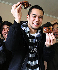 GOOD KAI: Invercargill-born Japanese singing superstar Jay'Ed enjoys muttonbirds with his Japanese film crew during a brief visit to his home town yesterday.