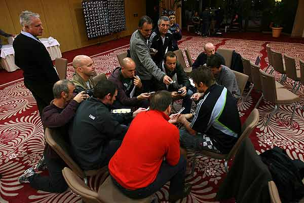 All Blacks captain Richie McCaw is a centre of a media scrum after the team was named to play France in Marseille