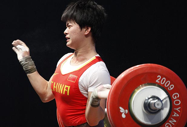 Guo Xiyan of China drops the weight as she makes an unsuccessful attempt in the women's 63kg Group A weightlifting clean and jerk competition at the World Weightlifting Championships.