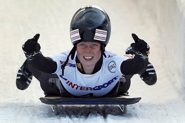 Marion Trott of Germany reacts after crossing the finish line in the women's skeleton race during the FIBT Bobsleigh and Skeleton World Cup competition at the Olympic track in Cesana Pariol, northern Italy.