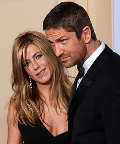 Jennifer Aniston and Gerard Butler were reportedly spotted 'making out' at the Golden Globe Awards.