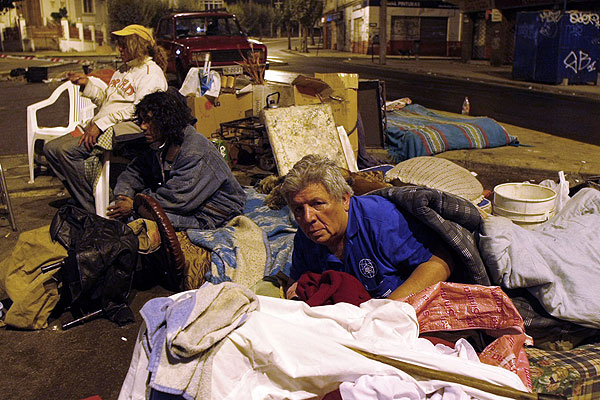 Residents sleep in the streets for fear of aftershocks following a major earthquake in Valparaiso, Chile.