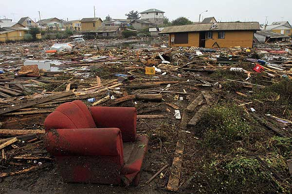 A view of debris on the coast, close to the epicentre of an earthquake that generated waves flooding many towns to the north and south, in Pelluhue.
