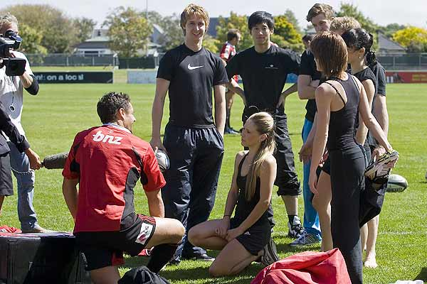 Lucy Balfour (centre) and other members from the Royal New Zealand Ballet talk to  All Blacks star Dan Carter during Crusaders rugby training at Rugby Park.