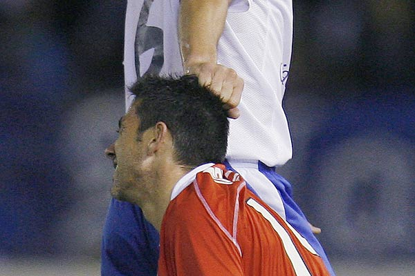 Tenerife's Pablo Sicilia pulls the hair of Real Mallorca's Jose Luis Marti during their Spanish First Division football match at the Heliodoro Rodriguez Lopez stadium in Santa Cruz de Tenerife.