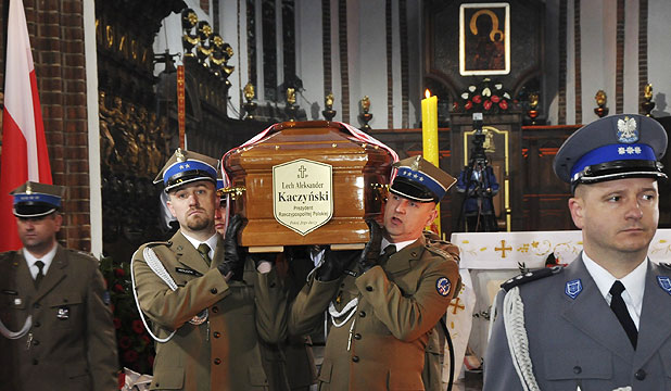 Soldiers carry the coffin of late Polish President Lech Kaczynski during a short mass inside the Cathedral of St. John in Warsaw.