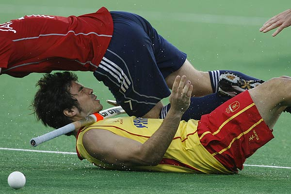 Spain's Miquel Delas (bottom) reacts after he collided with England's Ashley Jackson during their match at the men's Hockey World Cup in New Delhi.