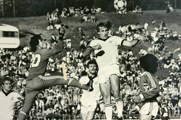 New Zealand's Brian Turner, watched by teammates Grant Turner (left) and Ricki Herbert, beats Indonesia's goalie to the ball during a 1981 qualifying match for the 1982 World Cup.