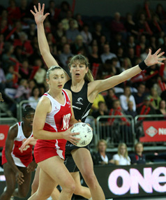 Irene van Dyk defends against Jade Clarke