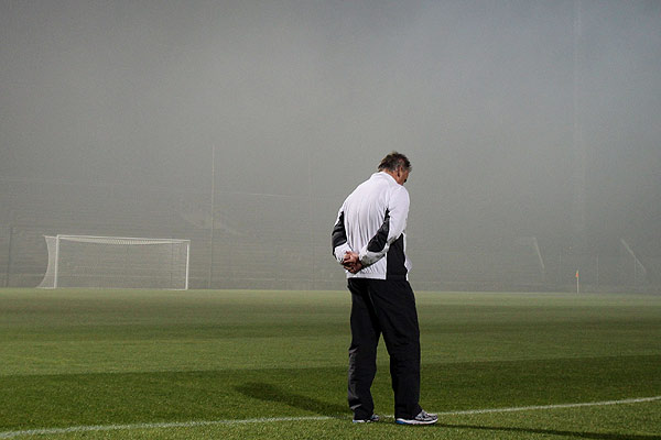 Assistant coach Brian Turner struggles to decide whether or not to get the All Whites off the bus for a training run in thick coal and wood smog.