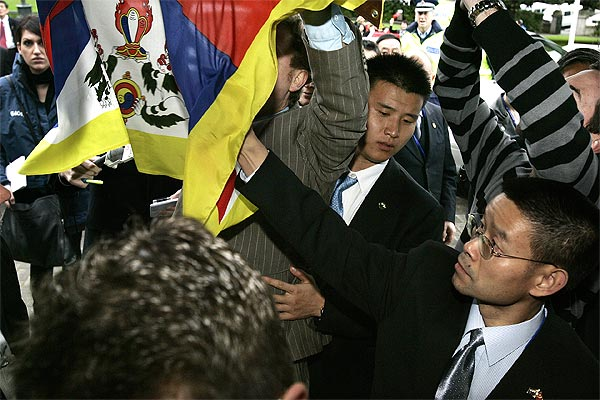Green MP Russel Norman gets a Tibetan flag torn from his hands by a member of Chinese Vice President Xi Jinping's entourage when he arrived at Parliament.