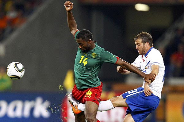 Netherlands' Rafael van der Vaart (right) kicks between the legs of Cameroon's Aurelien Chedjou during a 2010 World Cup Group E football match at Green Point stadium in Cape Town.