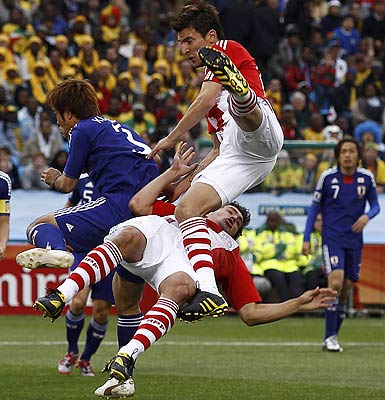 Paraguay's Edgar Benitez (top) and Cristian Riveros (16) fall during the 2010 World Cup second round football match against Japan at Loftus Versfeld stadium in Pretoria.