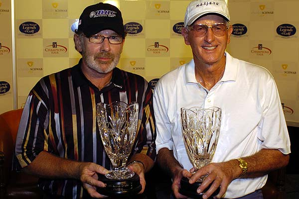 Stewart Ginn and Bob Charles win the Raphael Division of the Liberty Mutual Legends of Golf tournament in 2004 in Savannah, Georgia.