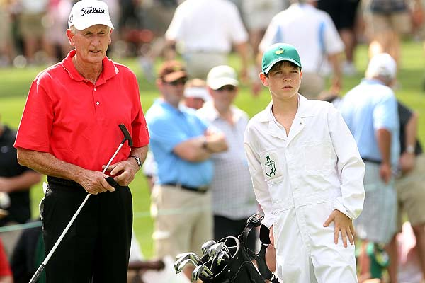Sir Bob Charles waits with his grandson/caddie Robert during the par three contest prior to the 2010 Masters Tournament at Augusta National Golf Club in 2010.