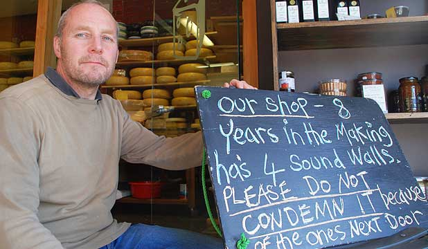 FICKLE FATE: Canterbury Cheesemongers owner Martin Aspinwall is afraid that with other buildings in his block set for demolition, his business will be forced to close.