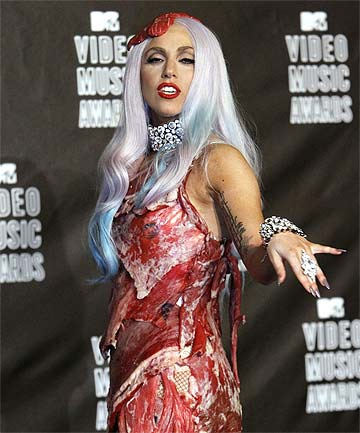 lady gaga meat dress images. IN THE FLESH: Lady Gaga in her