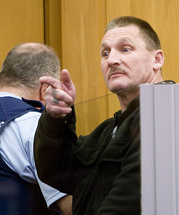CAREER CRIMINAL: Ainsley Anderson mocks Raymond Piper supporters in Porirua District Court in July.