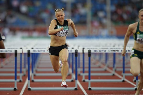 New Zealand's Andrea Miller races to a bronze medal in the women's 100m hurdles at the Commonwealth Games in Delhi.