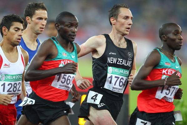 New Zealand's Nick Willis is sandwiched by Kenyans as he runs in the men's 1500m final at the Delhi Commonwealth Games.