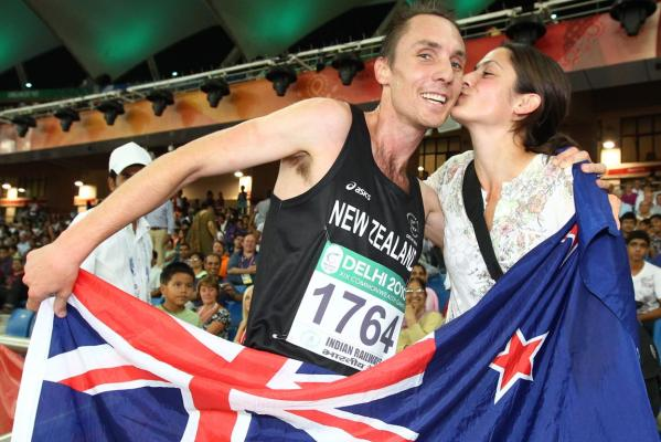 New Zealand's Nick Willis receives a congratulatory kiss from his wife after finishing third in the men's 1500m final at the Delhi Commonwealth Games.