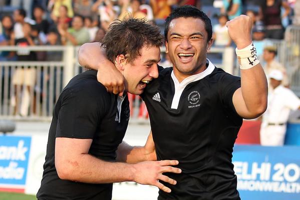 New Zealand's Kurt Baker (left) celebrates with teammate Sherwin Stowers after scoring the matchwinning try to beat Australia in the Sevens final at the Delhi Commonwealth Games.