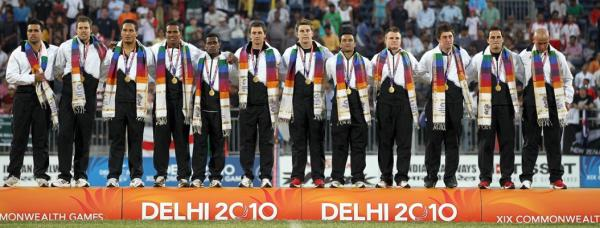 The New Zealand Sevens on the medal dais after receiving their gold medals for winning the final over Australia at the Delhi Commonwealth Games.