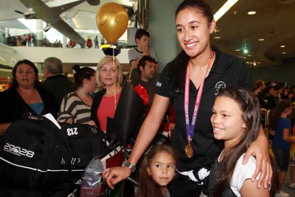 Silver Fern Maria Tutaia with fans as members of the New Zealand Commonwealth Games team arrive home in Auckland.