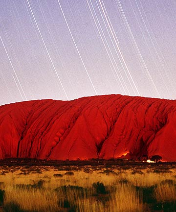 MYSTIC ROCK: Uluru and nearby Kata Tjuta have profound cultural and spiritual significance for the Anangu people.