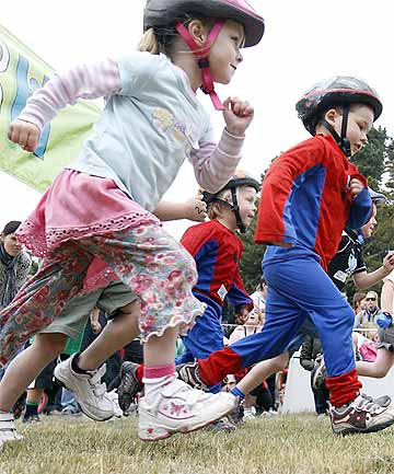 RACING: Charlotte Methven, 4, left, gets going in the Tiddlers Multisport at Rawhiti Domain in New Brighton yesterday.